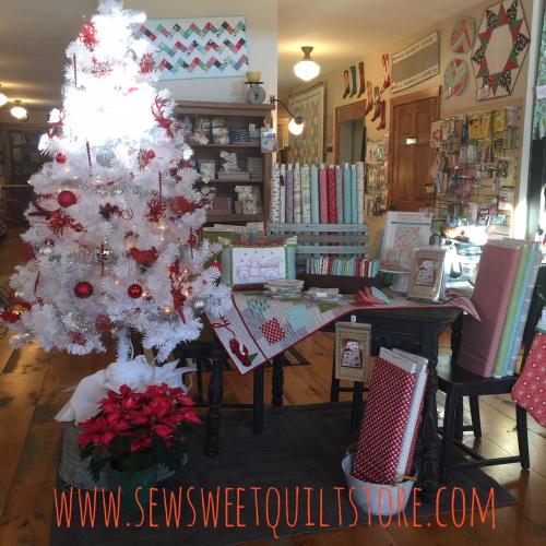 Christmas quilt shop display. quilt shop.